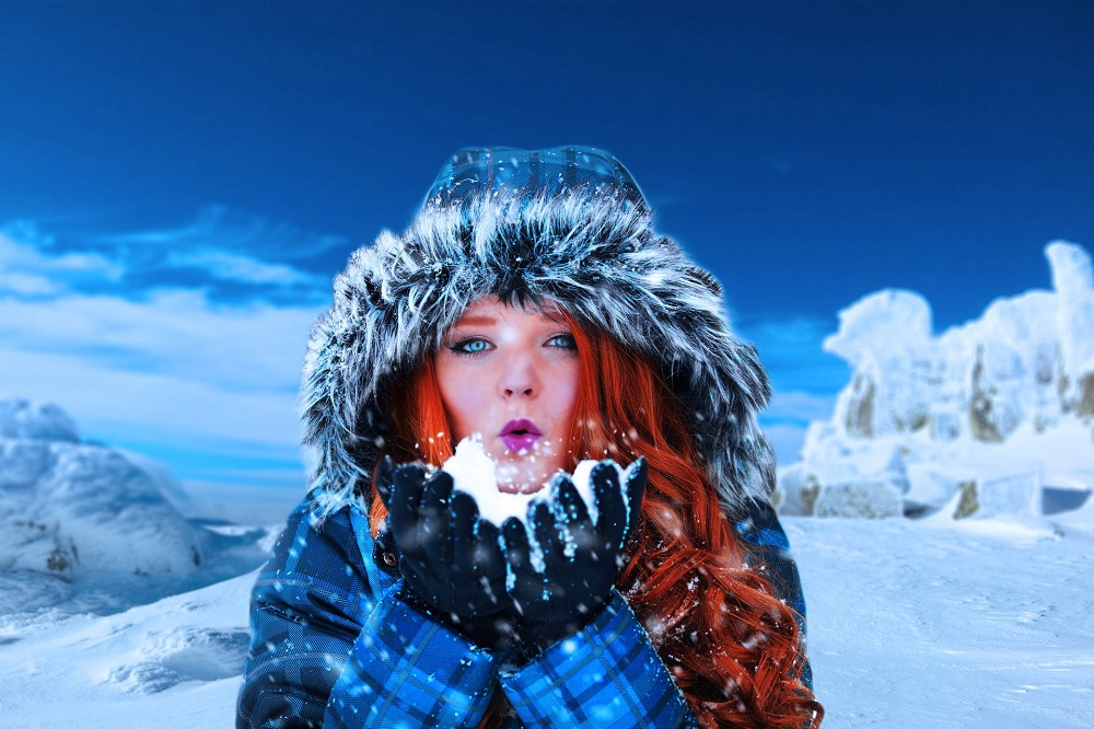 woman with red hair and blue ice in a fur parka in an ice theme, symbolizing the power of trusting your intuition