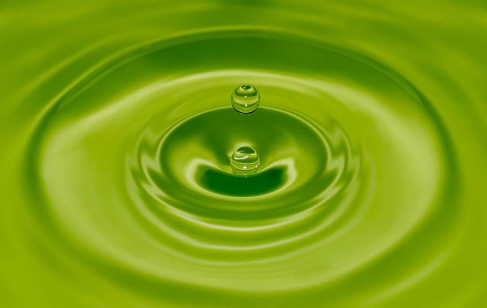 water is green, a water drop is dripping into the water, representing the power of spiritual practice