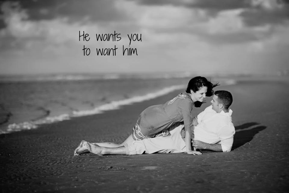 couple laying in the sand on the beach, teasing each other, wording on image, he wants you to want him, find the perfect man and prevent heartbreak