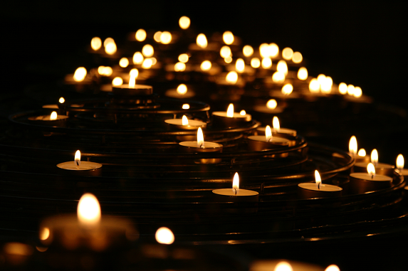 burning candle lights in the water, moving away from abuse towards love