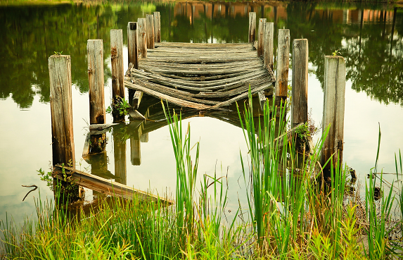 broken pier in a lake, symbolizing bad relationship rules
