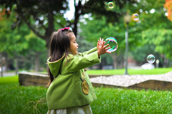 child is playing with a bubble in the air, inner child healing