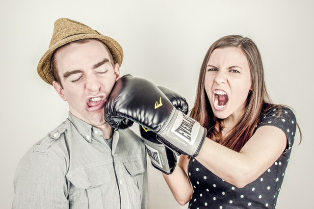 woman boxes a man in his face, how to keep peace with a spouse when you are upset