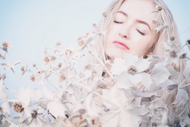 woman surrounded by beautiful white flowers, how to keep peace with a spouse